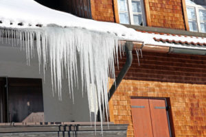 Roofing Company Help Snow Covered Roof