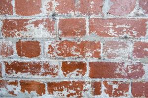 masonry restoration needed white paint peeling brick building