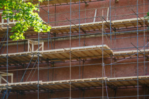 scaffolding brick wall masonry restoration old building