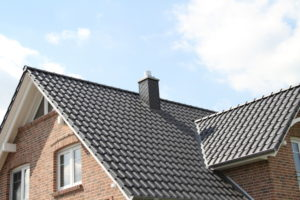 brick home tile roofing gray